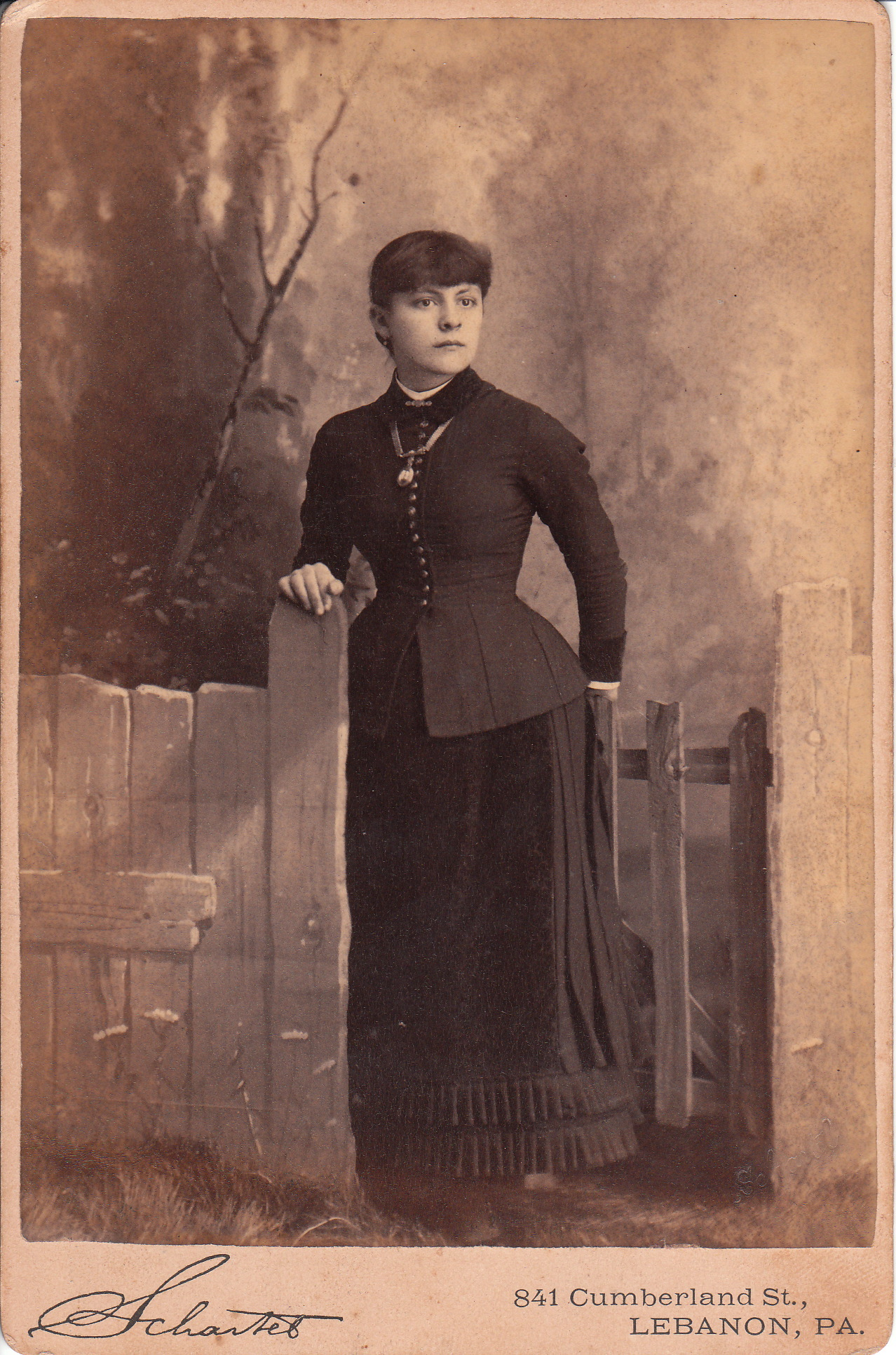 Post Mortem Photography Gallery Woman stands by fence post inPost Mortem Photography Gallery