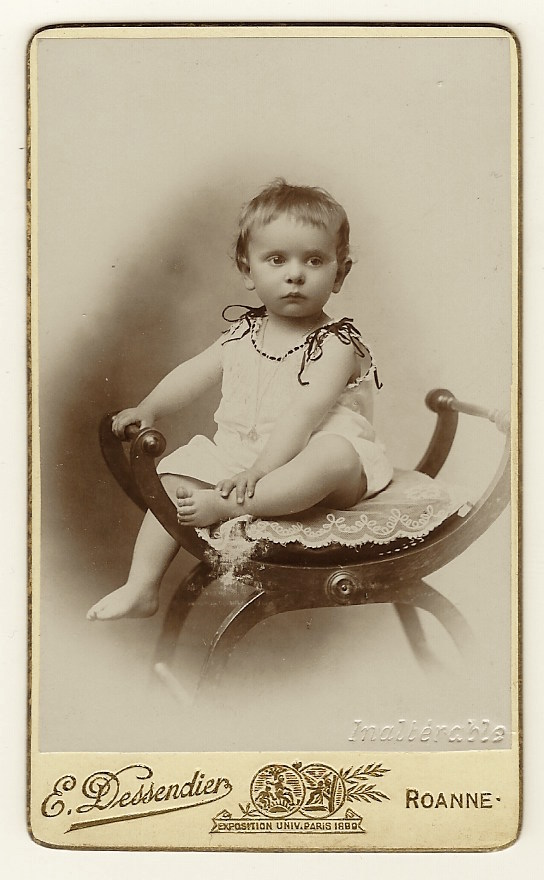 This Carte De Visite Features An Adorable Child Displaying A Skeptical But Very Inquisitive Expression The Toddler Is Sitting On Chair And Wearing