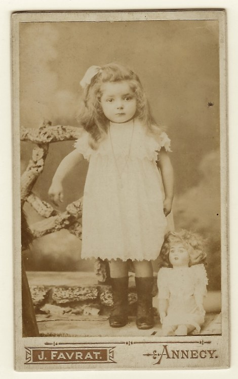 This Carte De Visite Photograph Features A Portrait Of An Adorable Little Girl She Has The Most Interesting Riveting Eyes Is Wearing Long Necklace